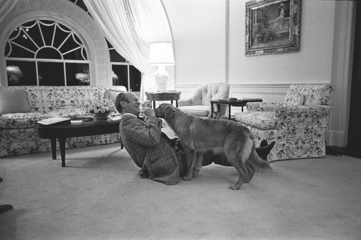 Ford playing with Liberty at the White House Executive Residence in 1975.