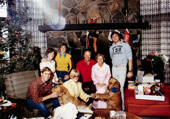 The Ford family celebrating Christmas in 1976 with Liberty and Misty.