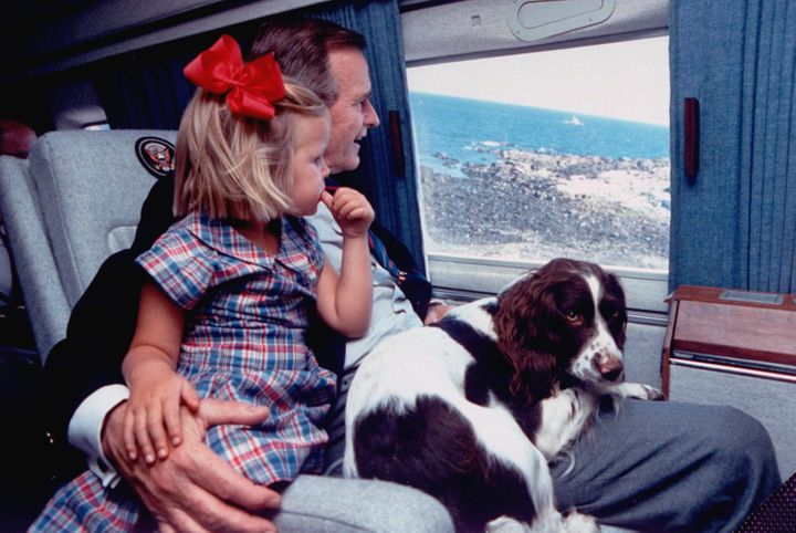 Bush with Ranger and his granddaughter Marshall in 1989.