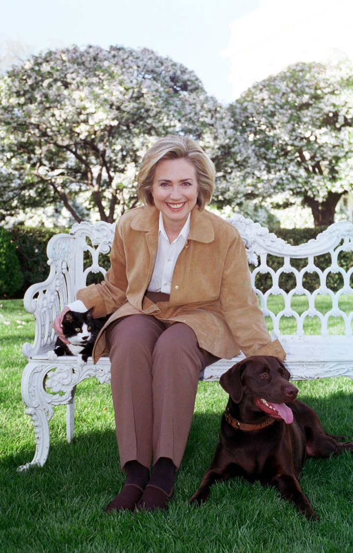 Then-First Lady Hillary Rodham Clinton poses with Socks and Buddy in 1999.