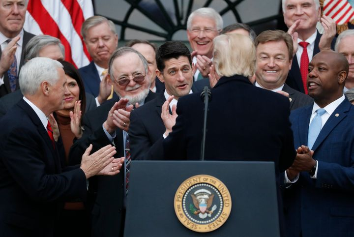 Vice President Mike Pence and House Speaker Paul Ryan (R-Wis.) applaud U.S. President Donald Trump after passing sweeping tax