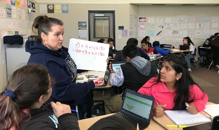 Jami Jorgensen, a math teacher at Martin Luther King Jr. Middle School in Hayward, teaches her students songs to help memoriz