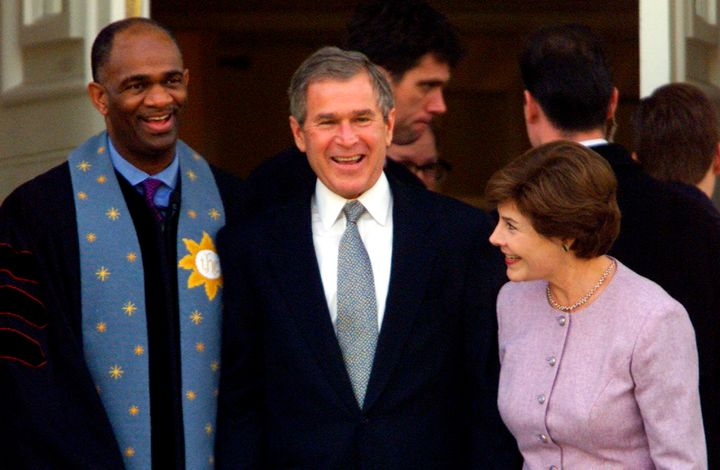 George W. Bush stands with his wife Laura andRev. Kirbyjon H. Caldwell after services at Tarrytown United Methodist Chu
