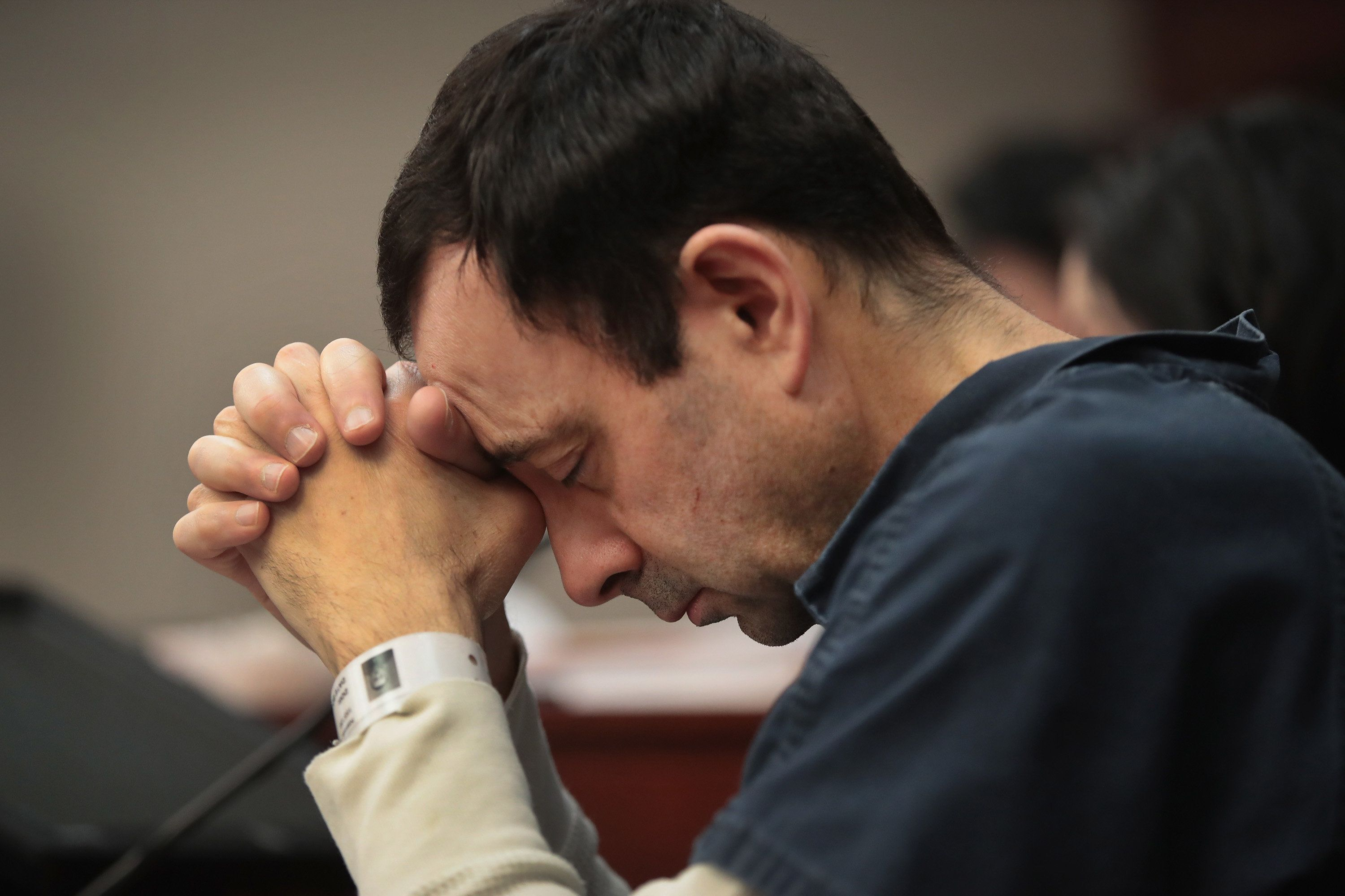 Larry Nassar listens to victim impact statements during a sentencing hearing on Jan. 16, 2018.