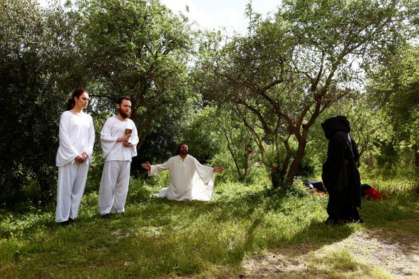 Actors interpret the scene of Jesus Christ in the Garden of Gethsemane during an interactive street-theater Passion play