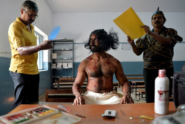 An Indian actor dressed as Jesus Christ prepares before re-enacting the crucifixion of Jesus Christ during a Passion play on