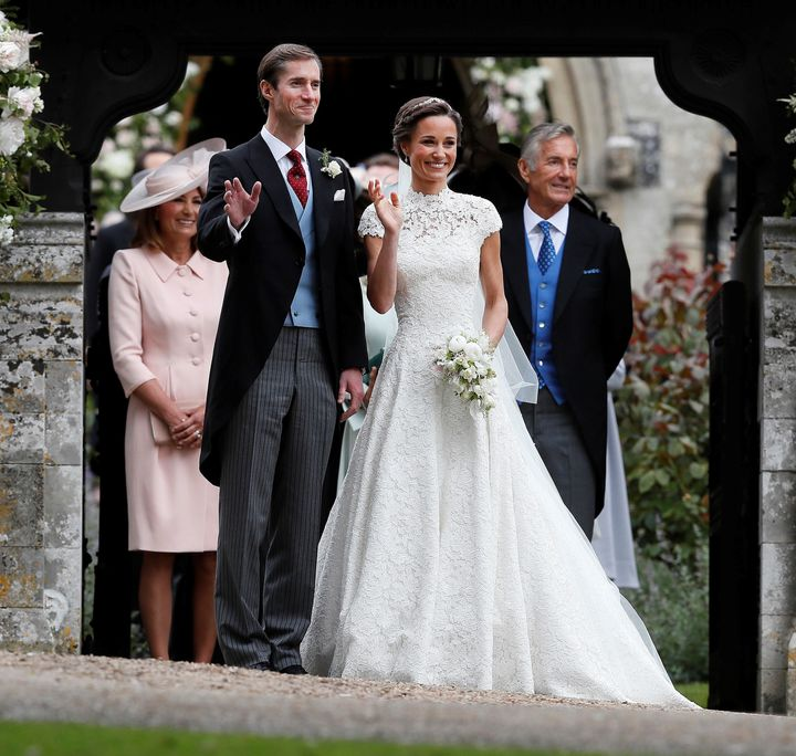 James Matthews poses last spring with his new bride, Pippa Middleton, as James' father, David Matthews (right), looks on.