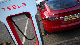 A Tesla car is charged at a Tesla dealership in West Drayton, just outside London, Britain, February 7, 2018. REUTERS/Hannah McKay