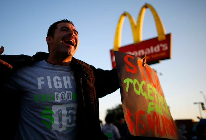 Striking McDonald's worker Abran Escarzaga, 31, protests outside McDonald's in Los Angeles, California, in December 2013