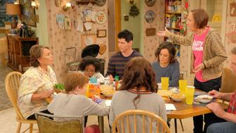 """ROSEANNE - """"Twenty Years to Life"""" - Roseanne and Dan adjust to living under the same roof with Darlene and her two children, Harris and Mark, when Darlene loses her job. Meanwhile, Becky announces she is going to be a surrogate to make extra money; and Roseanne and Jackie are at odds with one another, on the season premiere and first episode of the revival of """"Roseanne,"""" TUESDAY, MARCH 27 (8:00-8:30 p.m. EDT), on The ABC Television Network. (ABC/Adam Rose)ROSEANNE BARR, JAYDEN REY, MICHAEL FISHMAN, SARA GILBERT, LAURIE METCALF, JOHN GOODMAN"""