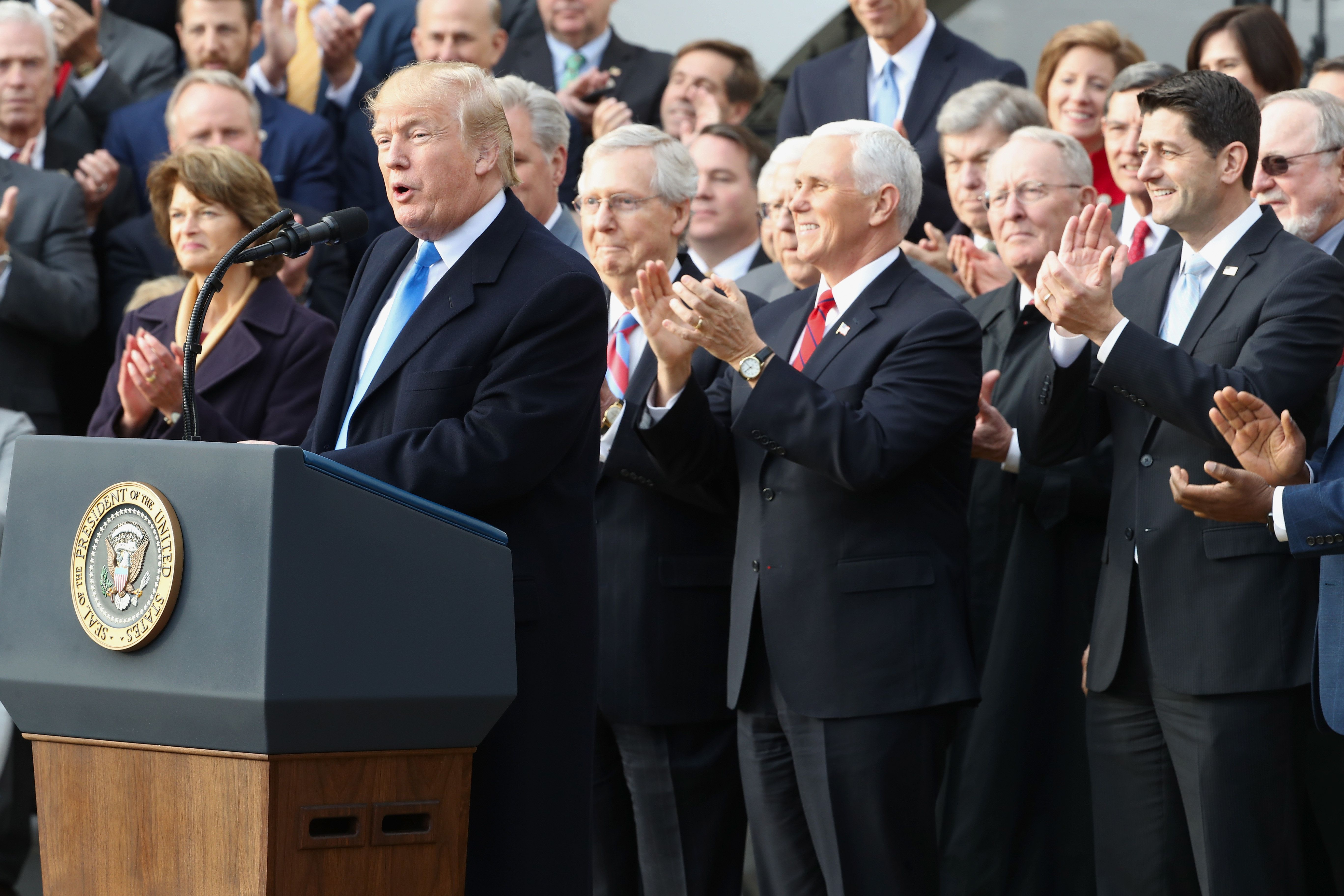 Republican lawmakers applaud president Donald Trump outside the White House, Dec. 20, 2017.