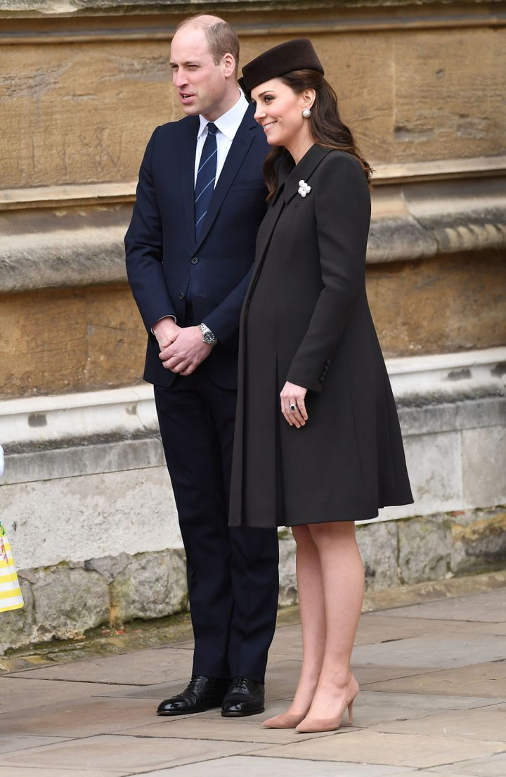 The duchess wore a black coat and matching hat.