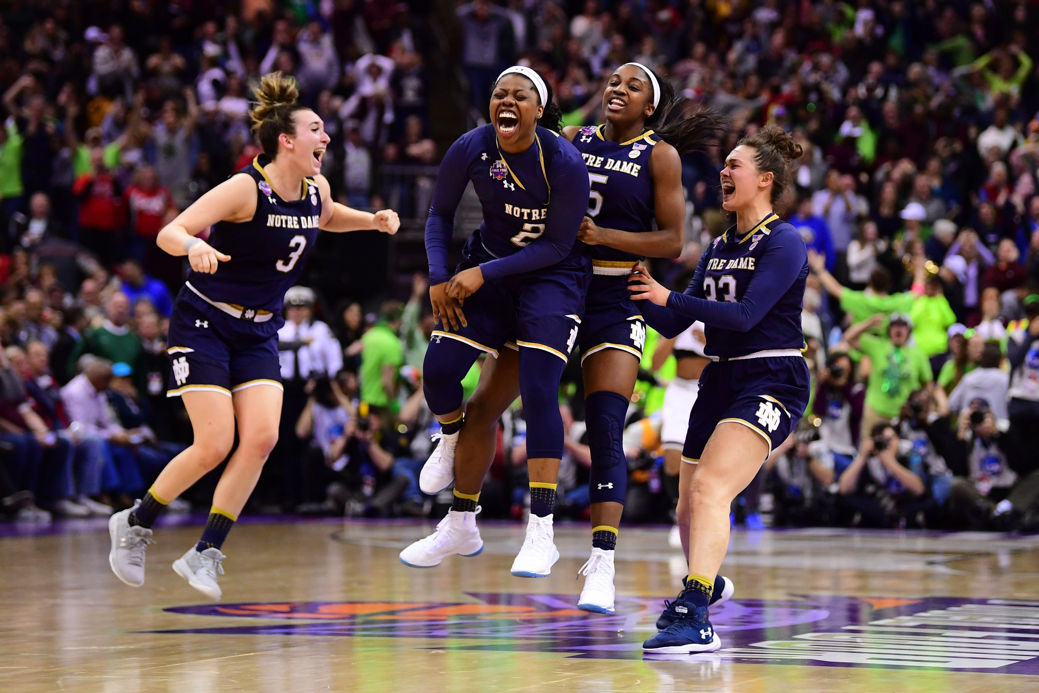 COLUMBUS, OH - APRIL 1: Notre Dame Fighting Irish players celebrate winning the championship against the Mississippi State Bulldogs at Nationwide Arena April 1, 2018 in Columbus, Ohio. (Photo by Ben Solomon/NCAA Photos via Getty Images)