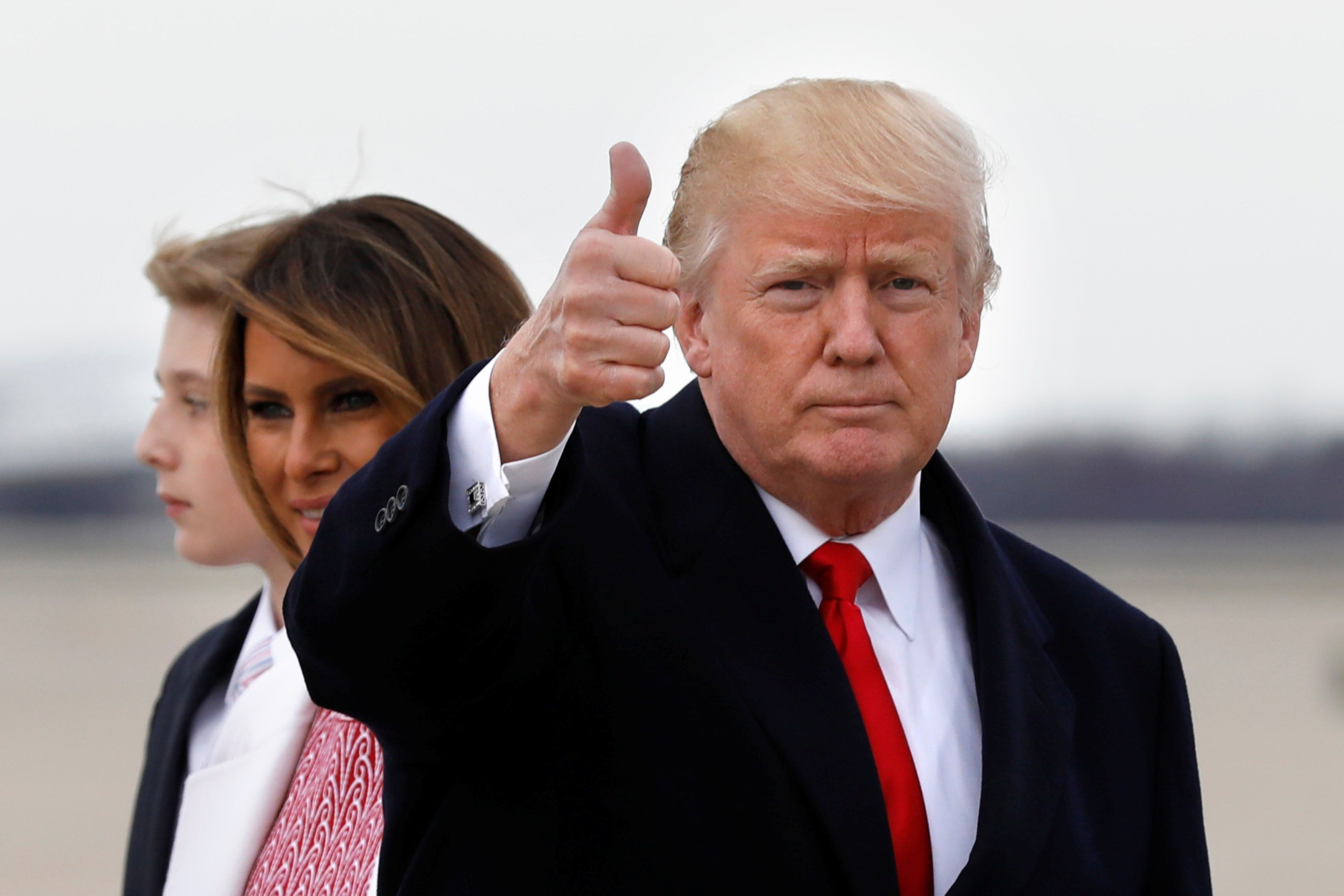 U.S. President Donald Trump gestures to the media as he arrives with first lady Melania Trump and their son Barron at Joint Base Andrews in Maryland, U.S., after the Easter weekend in Palm Beach, Florida, April 1, 2018. REUTERS/Yuri Gripas