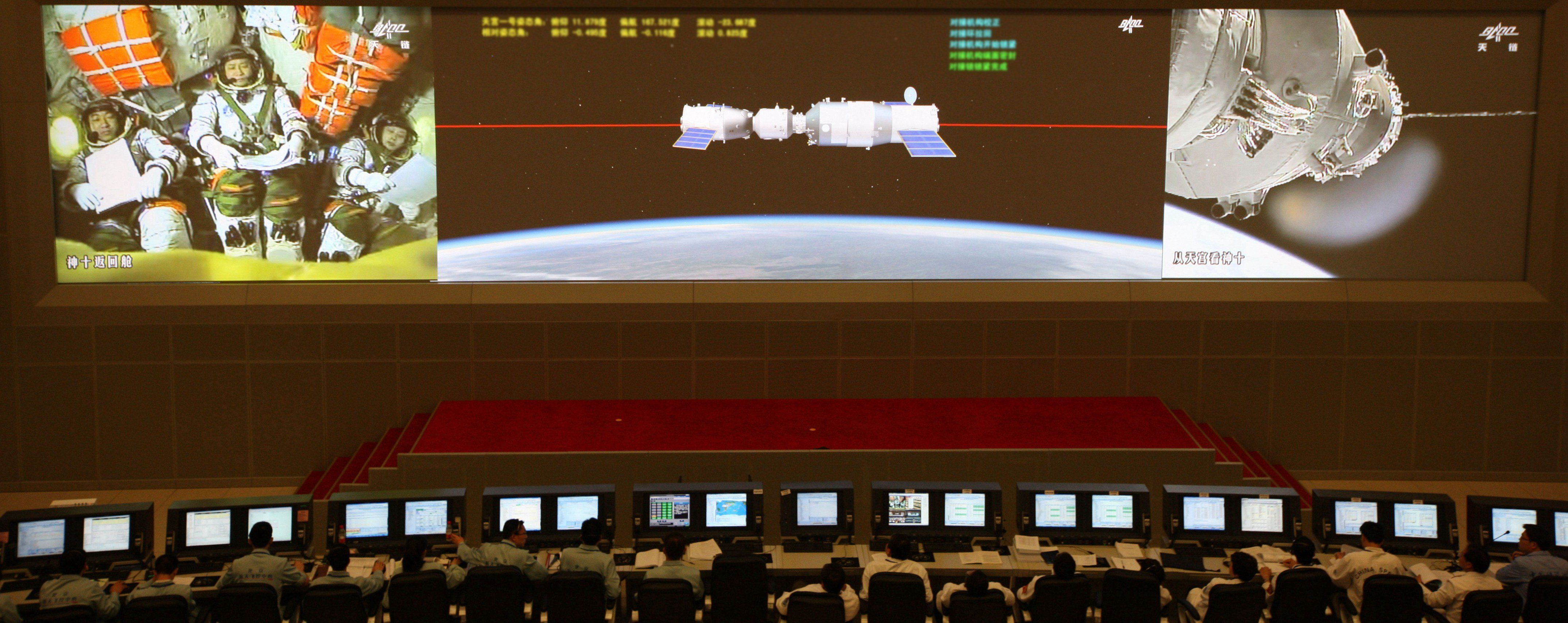 The Tiangong-1 re-entered Earth's atmosphere on Sunday evening. The Chinese said they lost contact with...