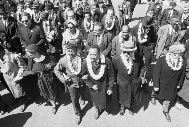 King, arm in arm with his chief aide, the Rev. Ralph Abernathy, leads marchers as they begin the Selma to Montgomery civil ri