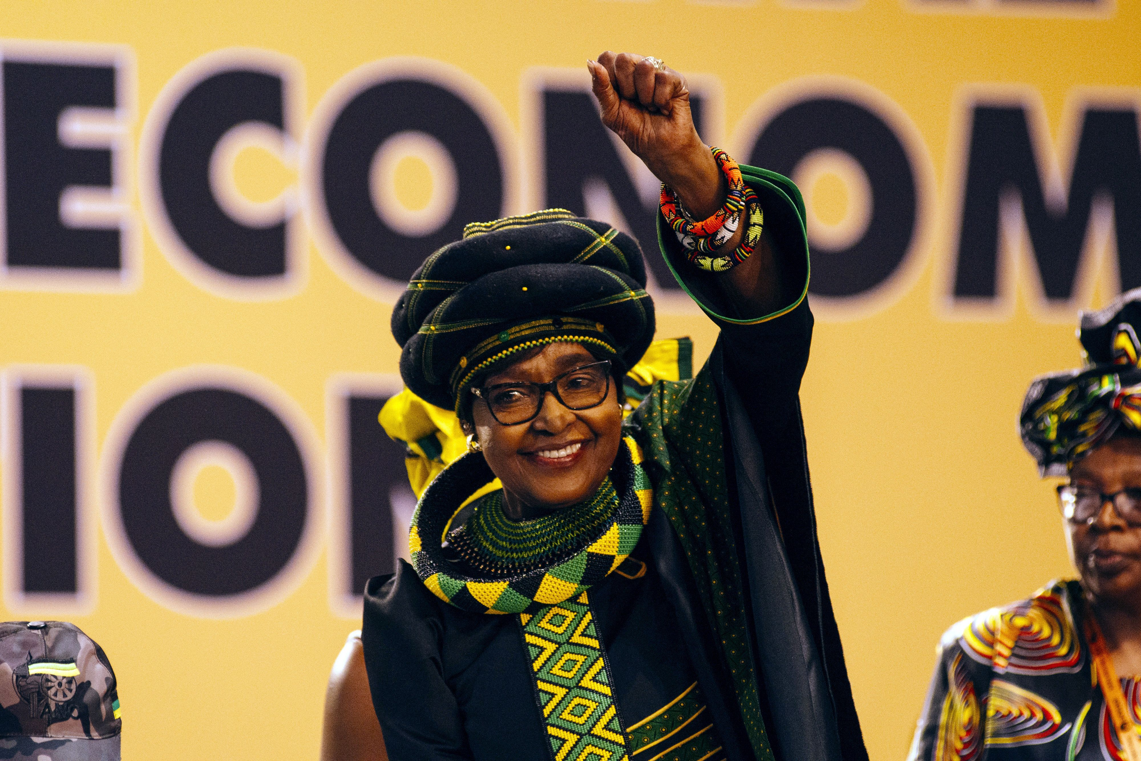 Winnie Madikizela-Mandela, wife of former president Nelson Mandela, greets the audience during the 54th national conference of the African National Congress party (ANC) in Johannesburg, South Africa, on Saturday, Dec. 16, 2017. South Africa's president Jacob Zuma urged the ruling African National Congress to fight factionalism and consider accommodating members of rival slates in its new leadership that will be elected at its national conference. Photographer: Waldo Swiegers/Bloomberg via Getty Images