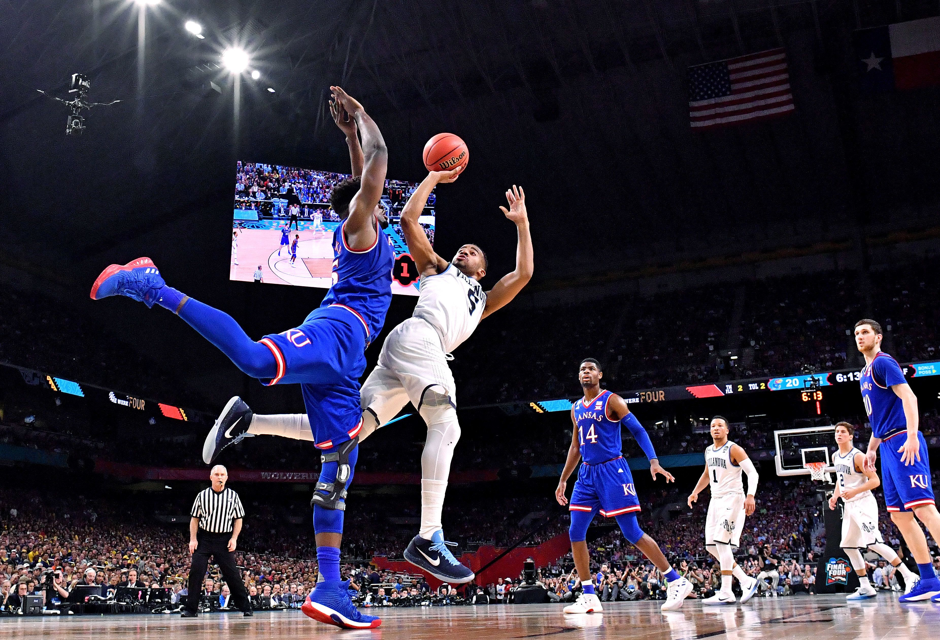 Villanova Wildcats guard Phil Booth shoots against Kansas Jayhawks center Udoka Azubuike during the first half of their