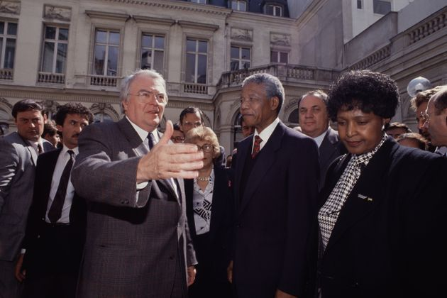 South African anti-apartheid activist and politician Nelson Mandela is seen with wife Winnie Madikizela-Mandela...