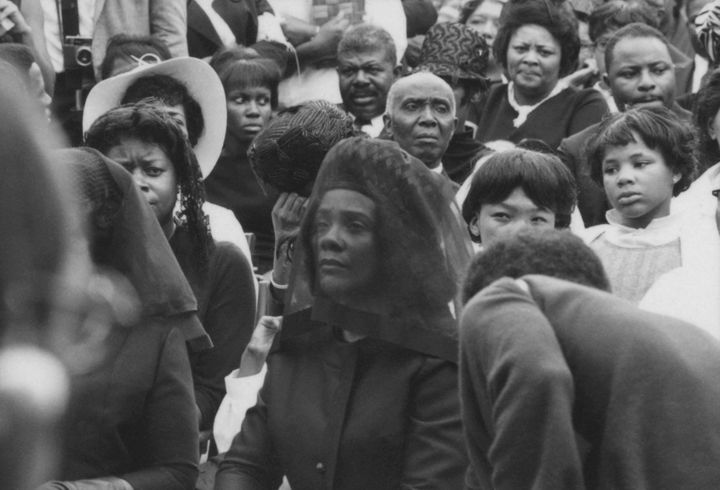 Coretta Scott King (1927 - 2006) listens to one of the speakers at the public memorial for her slain husband in Atlanta, Apri