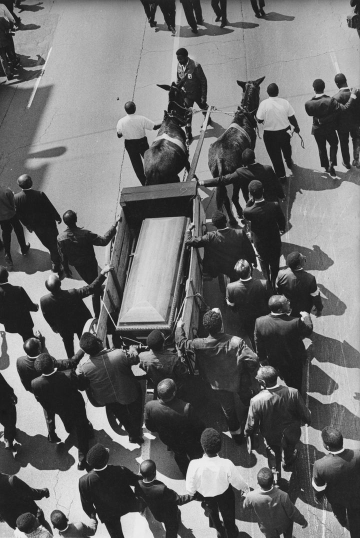 An overhead shot of Dr. Martin Luther King Jr.'s casket, during the procession from Ebenezer Baptist Church to Morehouse