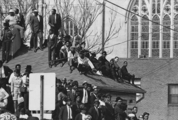 Onlookers crowding a rooftop in Atlanta on the day of MLK's funeral.
