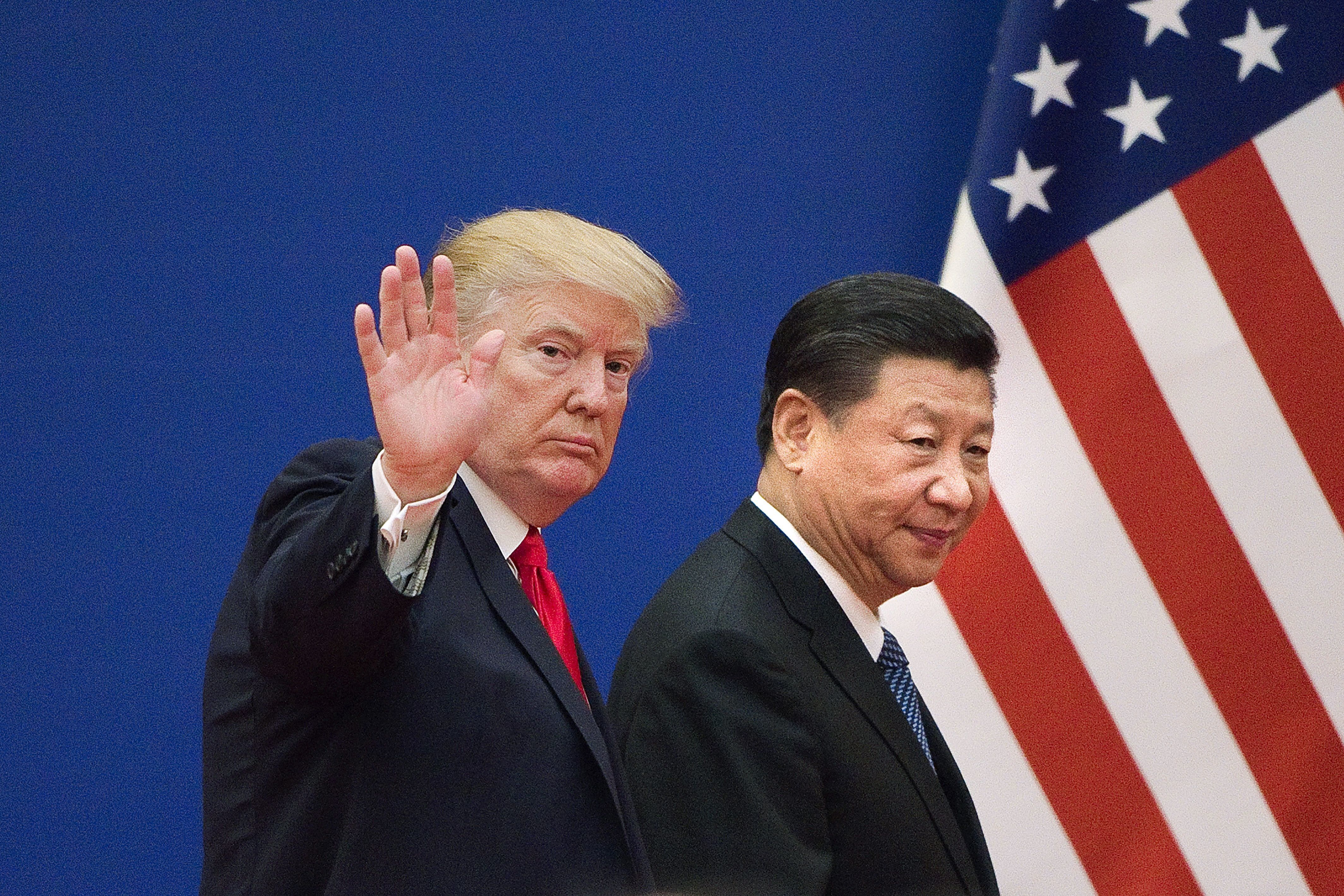 US President Donald Trump (L) and China's President Xi Jinping leave a business leaders event at the Great Hall of the People in Beijing on November 9, 2017. Donald Trump urged Chinese leader Xi Jinping to work 'hard' and act fast to help resolve the North Korean nuclear crisis, during their meeting in Beijing on November 9, warning that 'time is quickly running out'. / AFP PHOTO / Nicolas ASFOURI        (Photo credit should read NICOLAS ASFOURI/AFP/Getty Images)