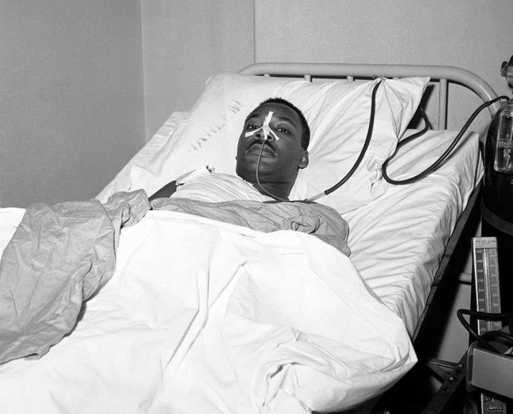 Martin Luther King Jr. recovers from surgery in bed at New York's Harlem Hospital following an operation to remove stee