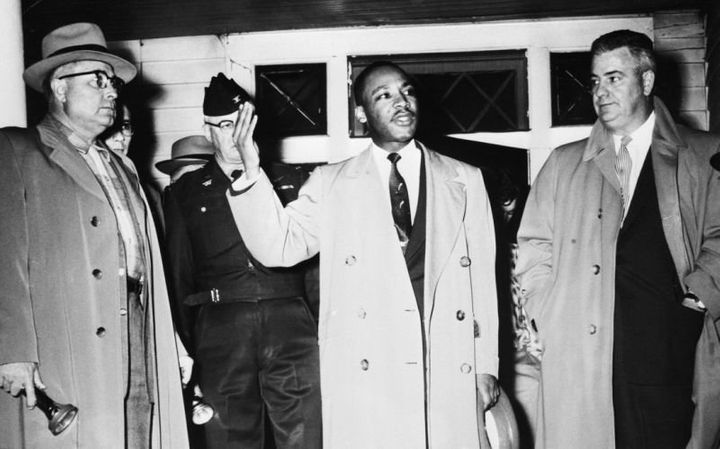 Martin Luther King Jr. urges calm from the porch of his home, which was damaged by a bomb during a boycott of the Montgomery,