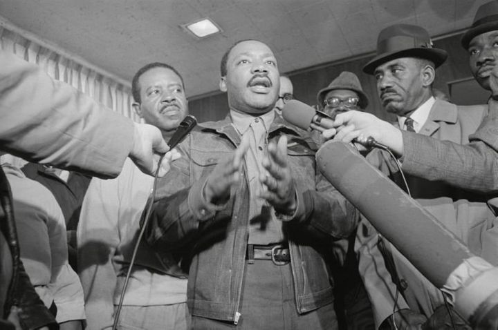 King and the Rev. Ralph Abernathy, left, are met by reporters as they emerge from the Jefferson County jail in Birmingham, Al