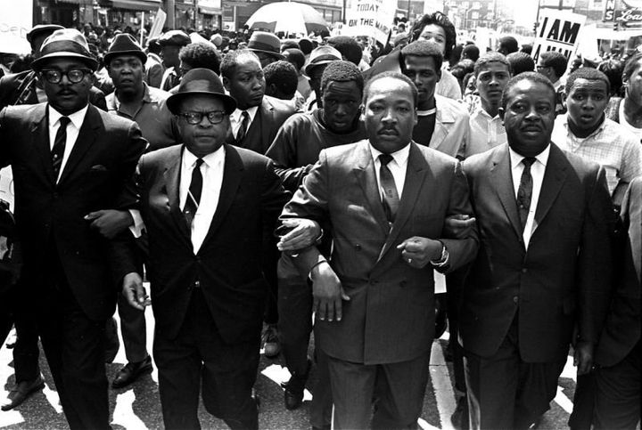 King is flanked by Abernathy, right, and Bishop Julian Smith, left, during a civil rights march in Memphis on March 28, 1968.
