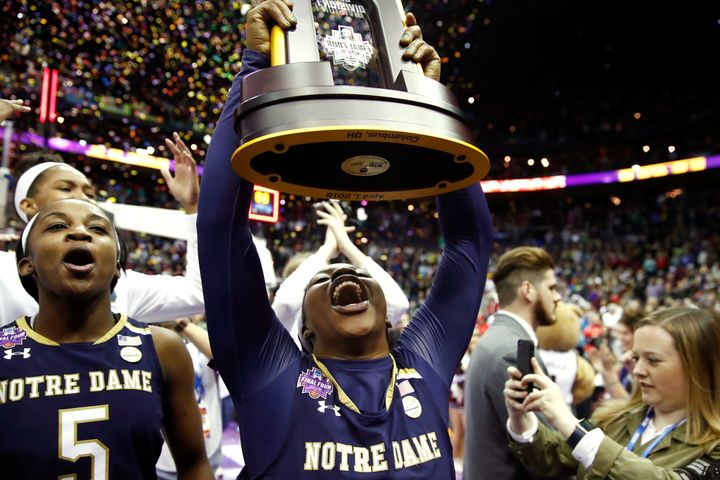 Ogunbowale holds high the NCAA championship trophy after Notre Dame defeated Mississippi State on April 1.