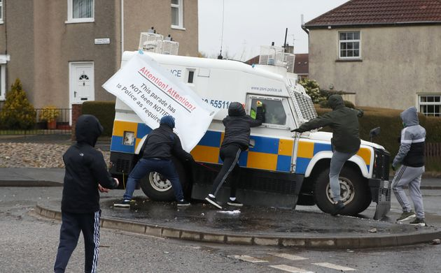 Youths attack police vehicles in the the Creggan area of Derry, Northern