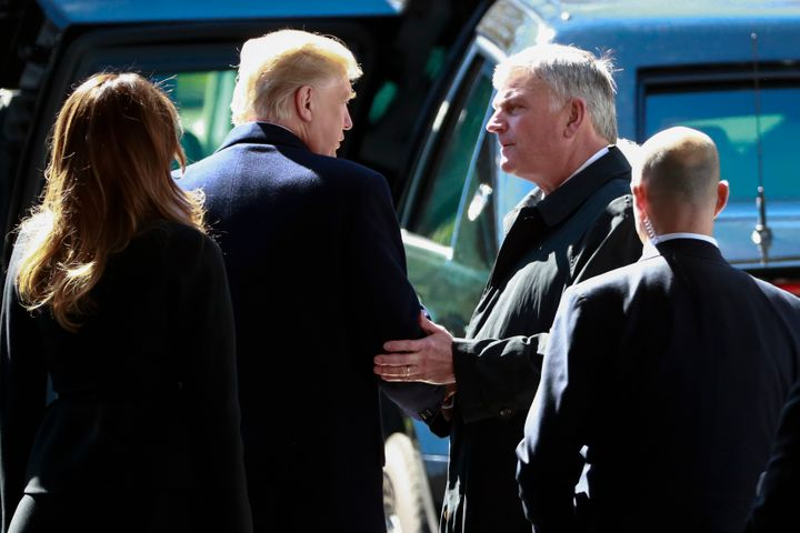 President Donald Trump speaks with Franklin Graham, right, during the funeral for his father, evangelist Billy Graham, on Mar