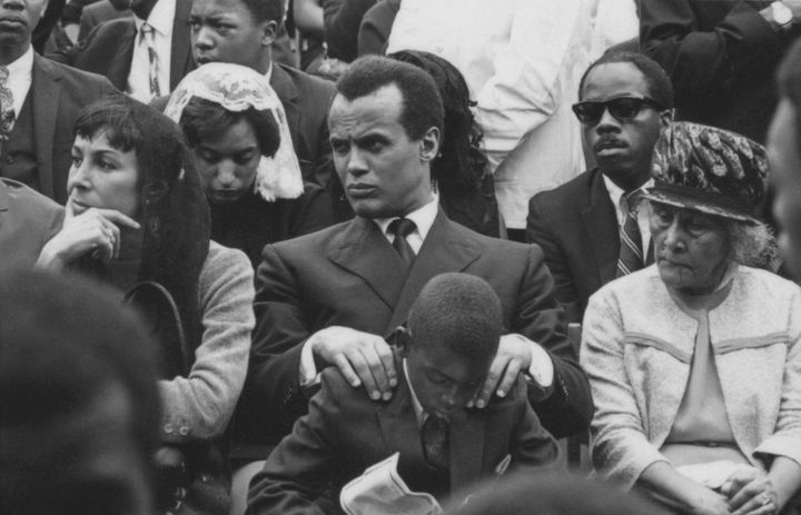 Actor, singer, and activist Harry Belafonte (center), his wife, Julie Robinson (left), and his son, David (seated in front of