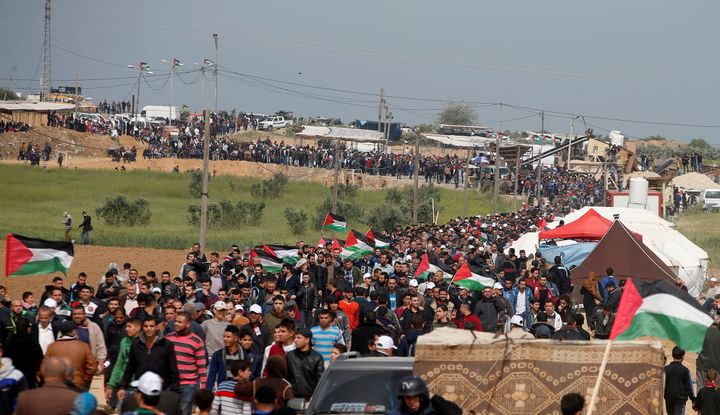 Palestinians attend a tent city protest along the Israel border with Gaza, demanding the right to return to their homeland, e