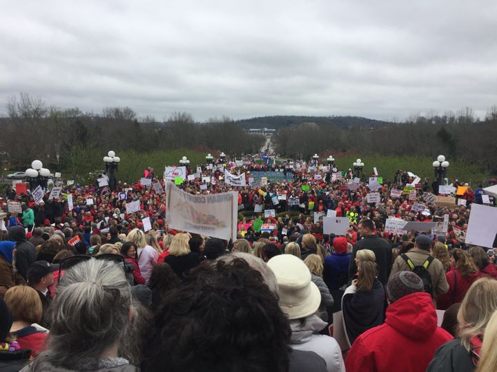 Overflow crowds spread down the Capitol steps as thousands of protesters gather in Frankfort, Kentucky, on Monday.