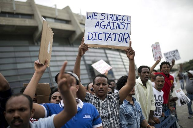 Eritrean refugees protest against the Eritrean government outside the nation's embassy in Tel Aviv, Israel,...