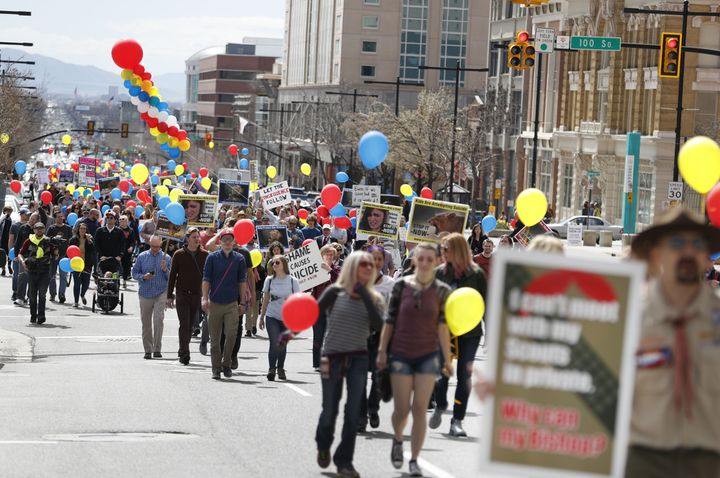 People march in downtown Salt Lake City on March 30, 2018. The protesters demanded that the Mormon church change its policy o
