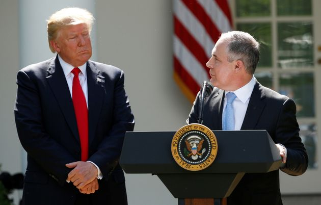 President Donald Trump listens to Scott Pruitt in the White House Rose Garden after announcing his decision...
