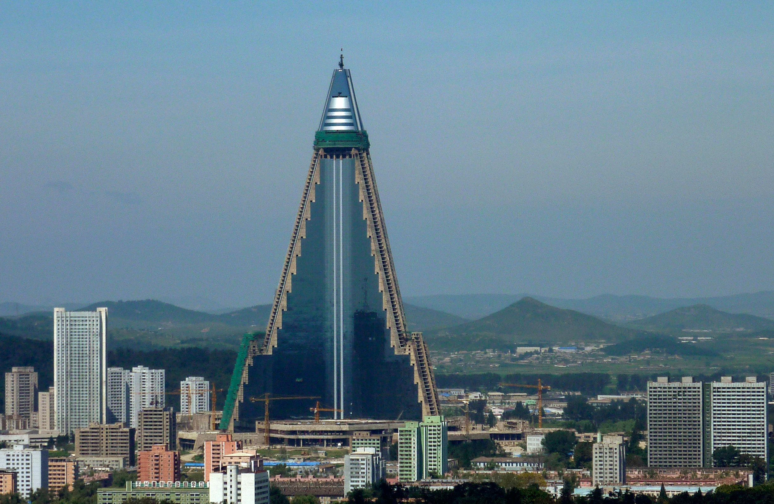 "Ryugyong Hotel is seen in Pyongyang in this picture taken August 28, 2009. The towering North Korean hotel, which Esquire magazine once dubbed ""the worst building in the history of mankind"", has come back to life with a facade of shiny glass windows affixed to one side of the concrete monolith. Picture taken August 28, 2009.      REUTERS/The Korea Sharing Movement/Handout (NORTH KOREA BUSINESS POLITICS SOCIETY) FOR EDITORIAL USE ONLY. NOT FOR SALE FOR MARKETING OR ADVERTISING CAMPAIGNS"