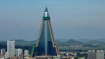 """Ryugyong Hotel is seen in Pyongyang in this picture taken August 28, 2009. The towering North Korean hotel, which Esquire magazine once dubbed """"the worst building in the history of mankind"""", has come back to life with a facade of shiny glass windows affixed to one side of the concrete monolith. Picture taken August 28, 2009.      REUTERS/The Korea Sharing Movement/Handout (NORTH KOREA BUSINESS POLITICS SOCIETY) FOR EDITORIAL USE ONLY. NOT FOR SALE FOR MARKETING OR ADVERTISING CAMPAIGNS"""
