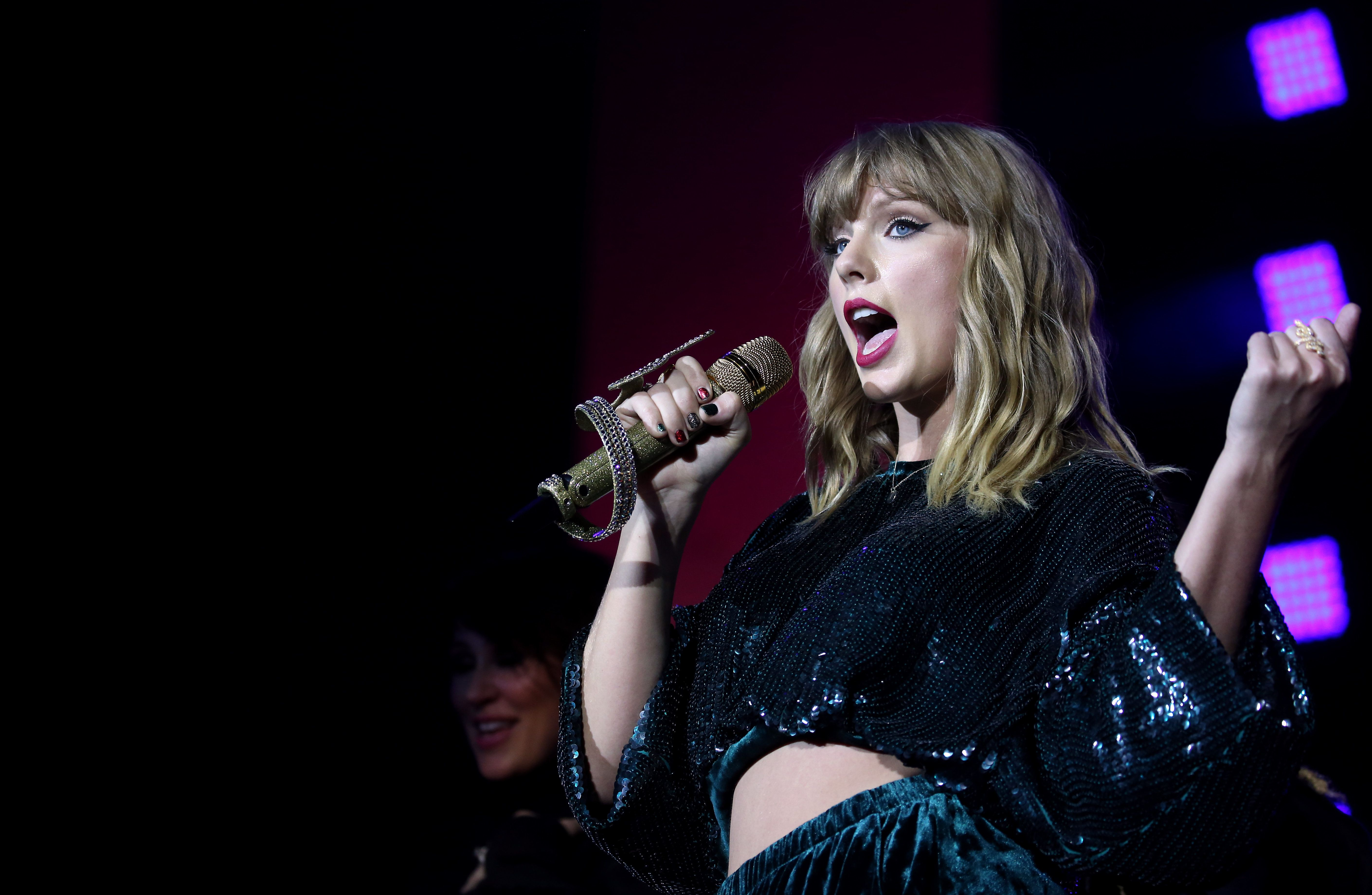 Taylor Swift performs on stage during day two of Capital's Jingle Bell Ball with Coca-Cola at London's O2 Arena. (Photo by Isabel Infantes/PA Images via Getty Images)