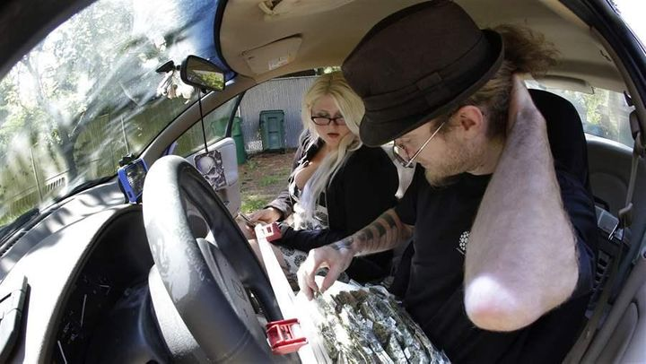 """Michael """"Billy the Kid"""" Kenworthy, a delivery driver in Seattle, seals a package of pot for a customer. Marijuana delivery bu"""