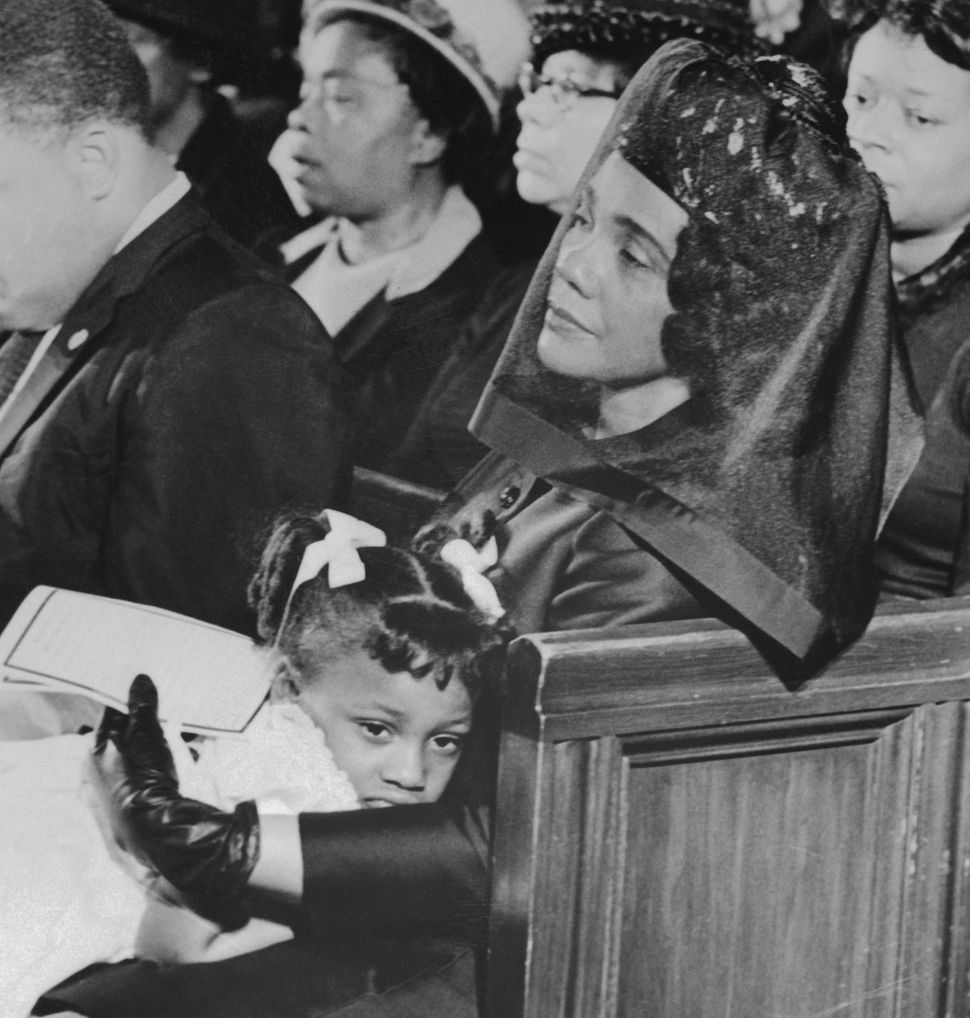 Coretta Scott King comforts her youngest daughter, 5-year-old Bernice, during the funeral service for Dr. Martin Luther King