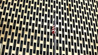 NEW YORK, NY - JANUARY 29:  An American Flag hangs in front of the federal building as dozens of immigration activists, clergy members and others participate in a demonstration against the imprisonment and potential deportation of immigration activist Ravi Ragbir in front of the Federal Building on January 29, 2018 in New York City. A federal judge ordered immigration activist Ravi Ragbir be released from custody on Monday, granting him a temporary reprieve from deportation to his native Trinidad and Tobago.  (Photo by Spencer Platt/Getty Images,)