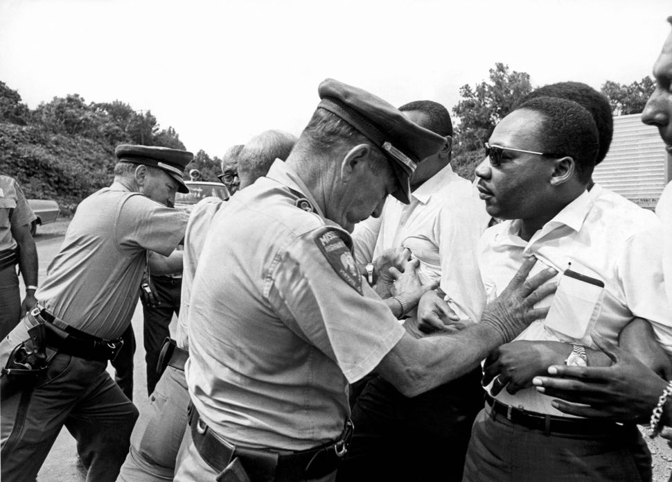Mississippi patrolmen shove Dr. Martin Luther King Jr. during the 220-mile March Against Fear from Memphis, Tennessee, to Jac