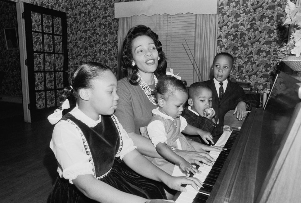 Coretta Scott King and her children celebrate the announcement that King was awarded the Nobel Peace Prize on Oct. 16, 1