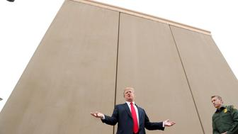 U.S. President Donald Trump speaks while participating in a tour of U.S.-Mexico border wall prototypes near the Otay Mesa Port of Entry in San Diego, California. U.S., March 13, 2018. REUTERS/Kevin Lamarque     TPX IMAGES OF THE DAY