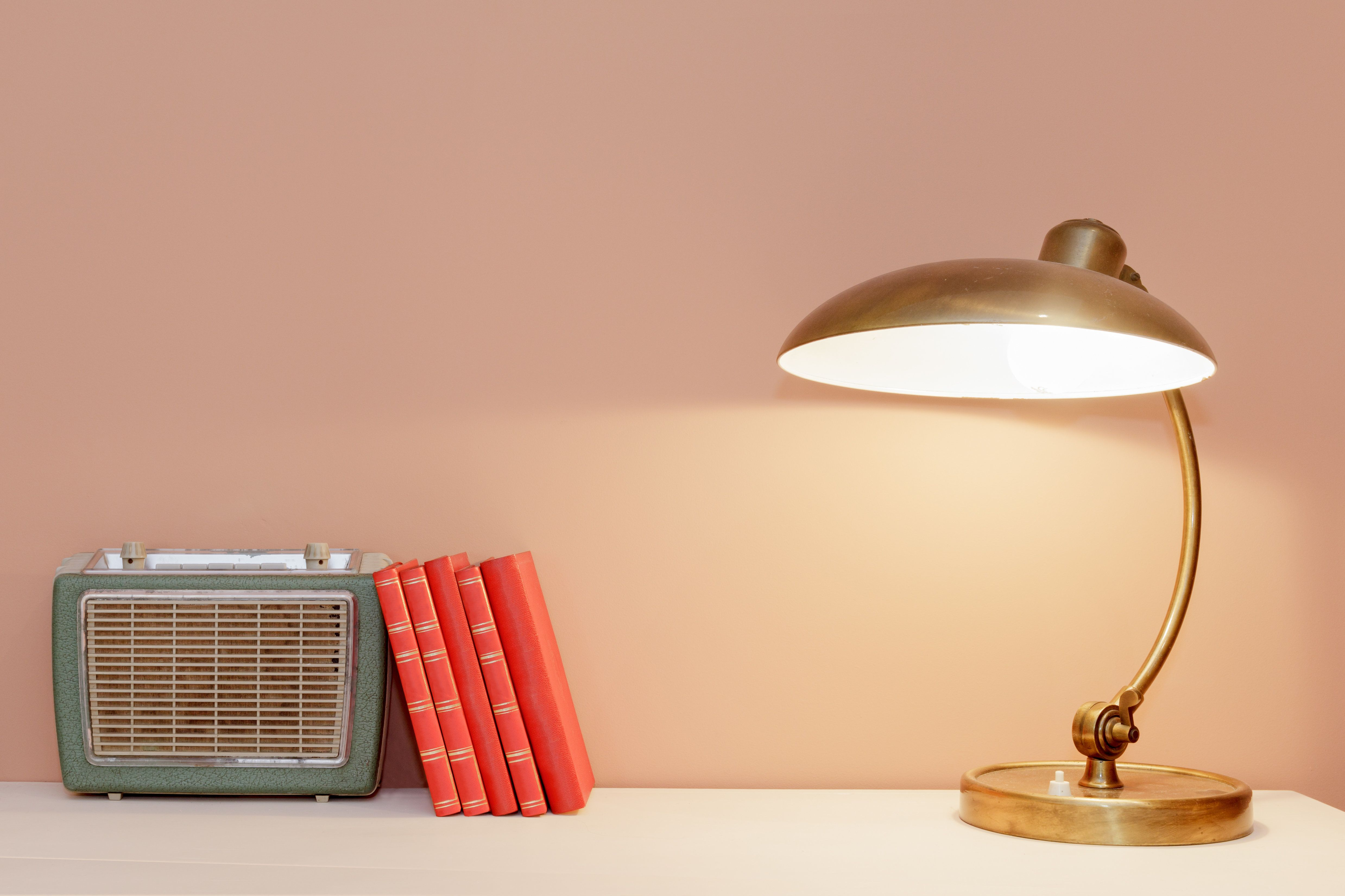 Retro Style Table With Lamp, Books and Radio